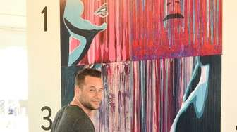 Live artist Jeremy Penn creates a painting at