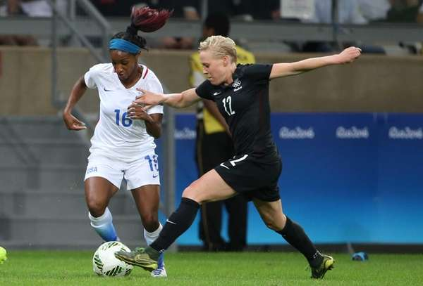 The United States' Crystal Dunn, left, and New