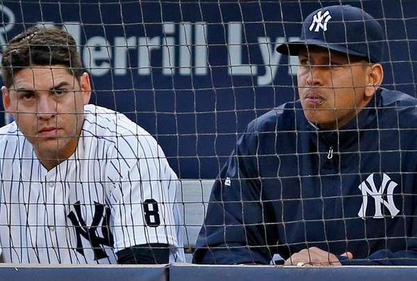 The New York Yankees' Alex Rodriguez, right, sits