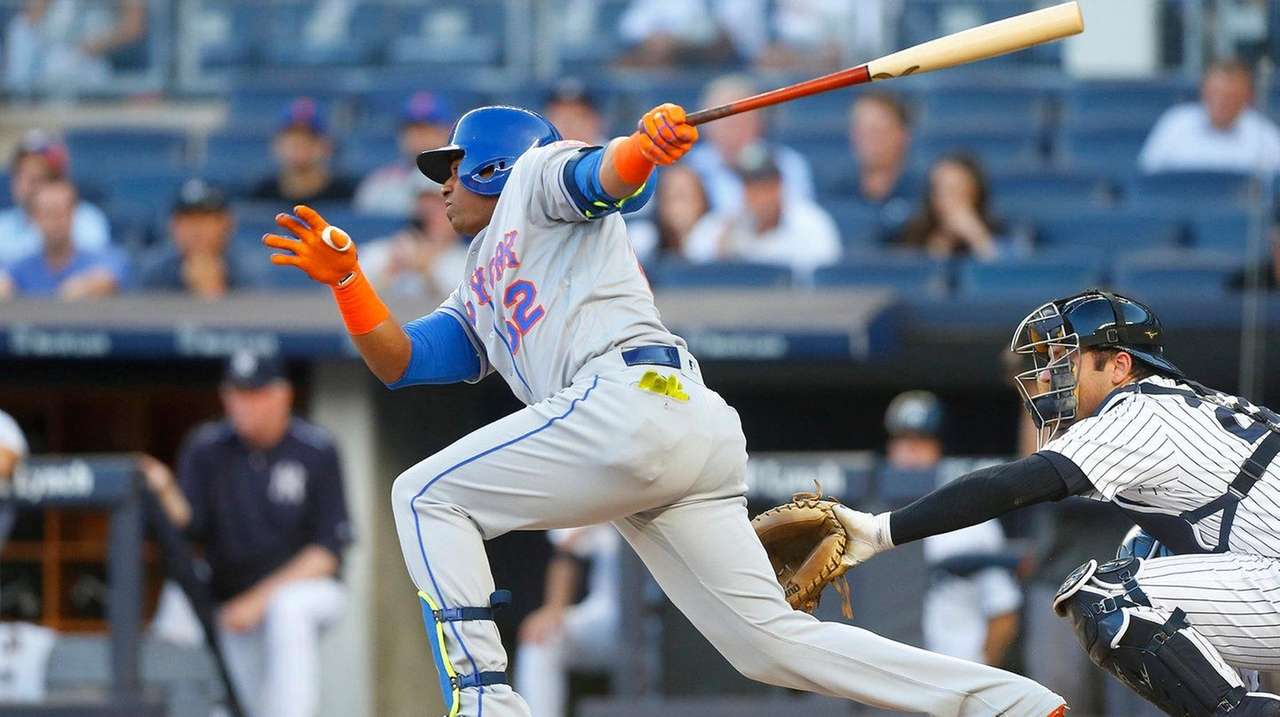 Yoenis Cespedes follows through on a first-inning single