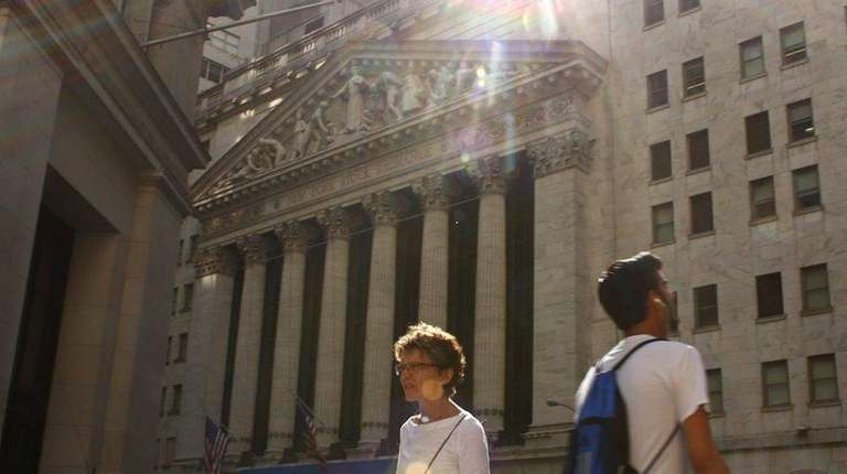 People pass by the New York Stock Exchange