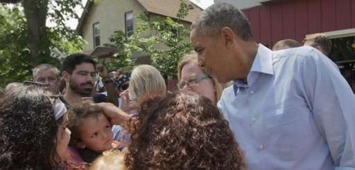 President Barack Obama greets a small child on
