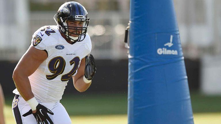 Baltimore Ravens defensive end Bronson Kaufusi runs a