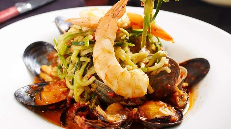 Shrimp, clams and mussels join zucchini linguine at