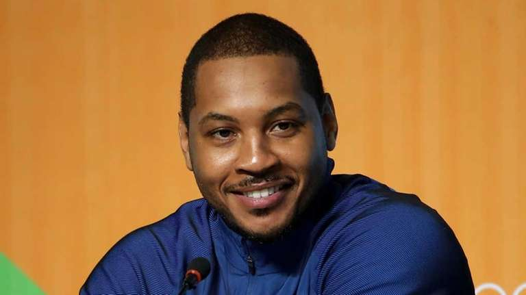 Carmelo Anthony of the United States speaks with