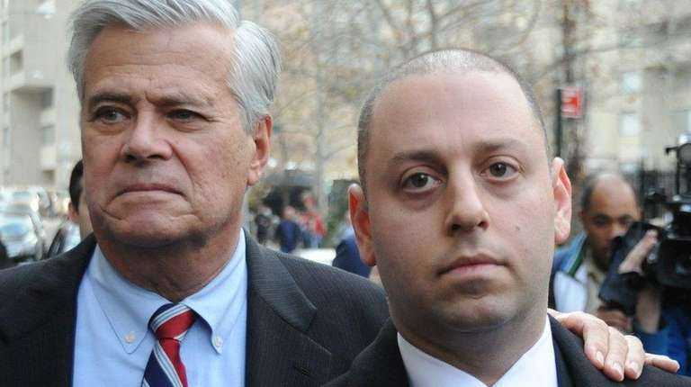 Dean Skelos and his son Adam leaving Federal