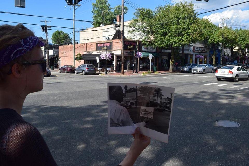 Courtney Maitland-White, of England, holds the 1963 photo