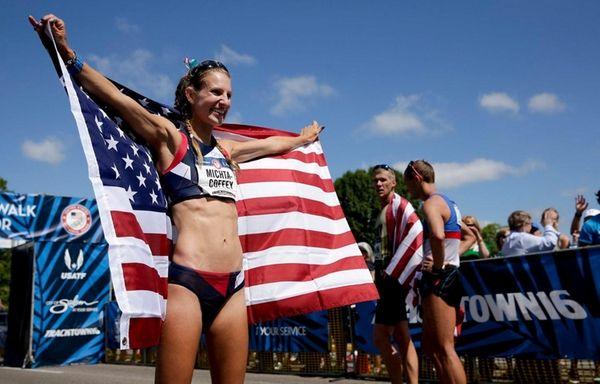 Maria Michta-Coffey, celebrates after winning the women's 20-kilometer