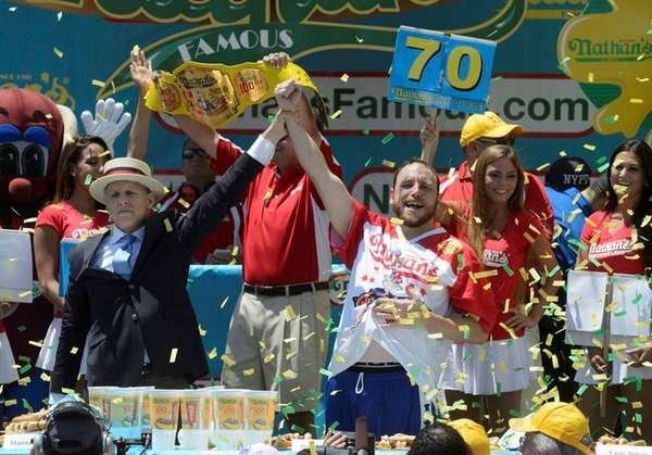 Joey Chestnut celebrates eating 70 hot dogs on