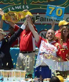 Joey Chestnut celebrates eating 70 hot dogs on