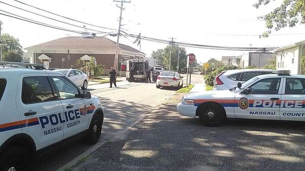 Nassau County police respond to Neptune Avenue and