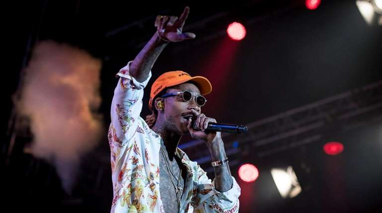 Wiz Khalifa, above, will perform with Snoop