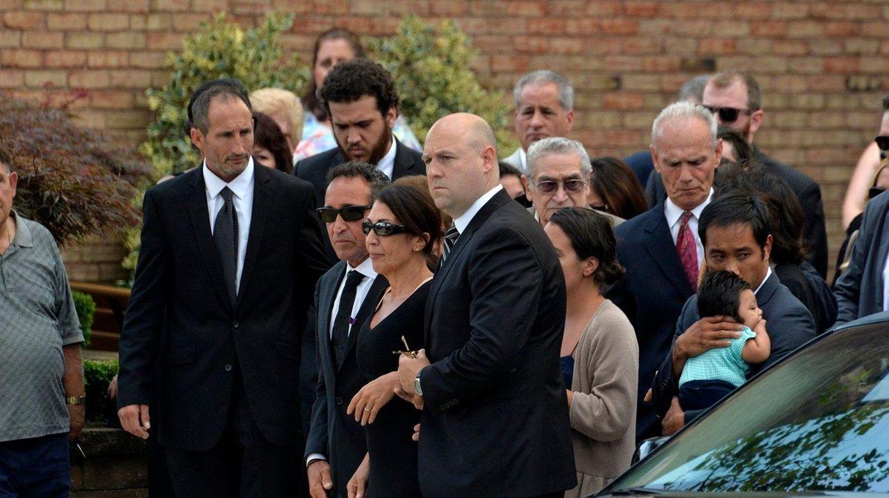 The parents of Karina Vetrano walk into St.
