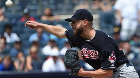 Cleveland Indians starting pitcher Corey Kluber delivers against
