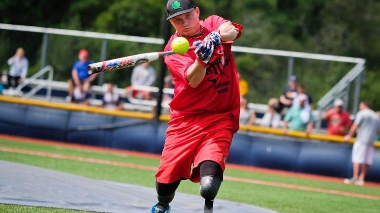 Marine veteran Josh Wege hits a ball as