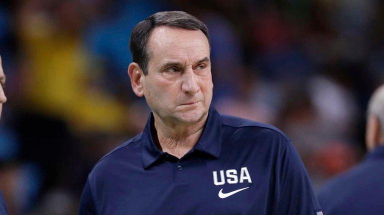 United States head coach Mike Krzyzewski walks on