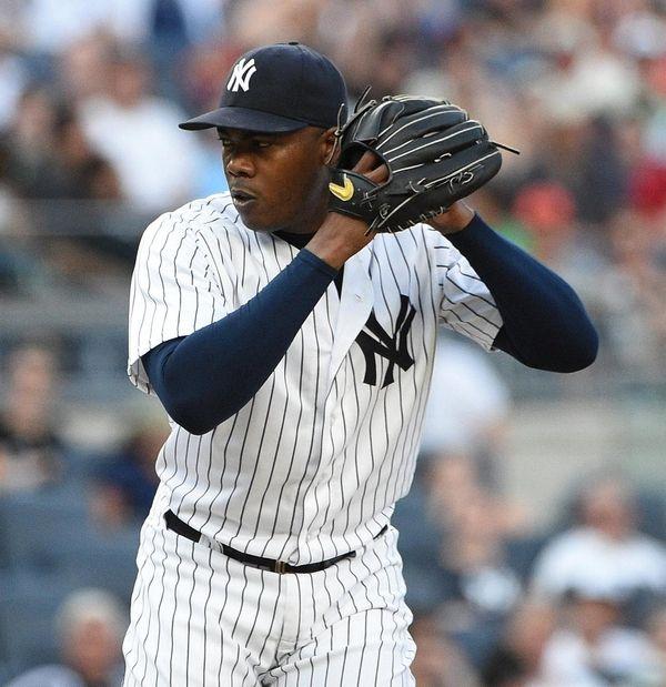 New York Yankees relief pitcher Aroldis Chapman delivers
