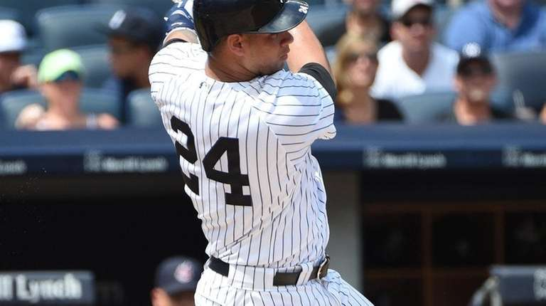 New York Yankees catcher Gary Sanchez follows through