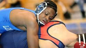Long Beach's Jacon Teemer competes in his 132-pound