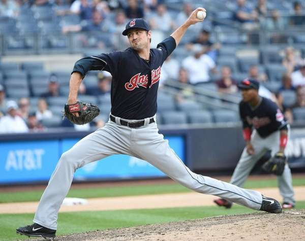Cleveland Indians relief pitcher Andrew Miller delivers a