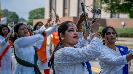 Members of Dhol Tasah Jallosh dance during Long