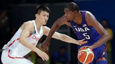 United States' Kevin Durant (5) drives past China's