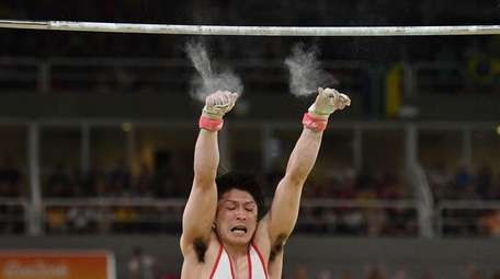 Japan's Kohei Uchimura falls while competing in the