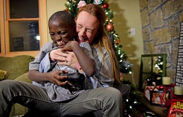 Jennifer Crean hugs Dunia Sibomana in her home