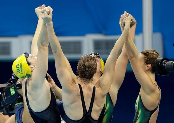 Australia teammates celebrate winning the gold in the