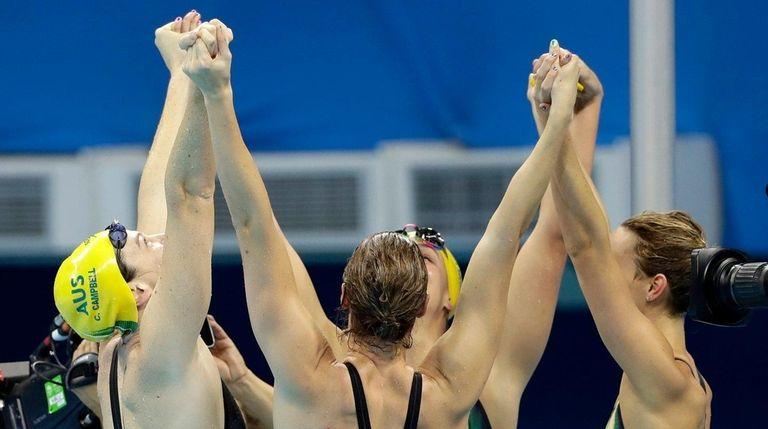 Australia teammates celebrate winning the gold in the