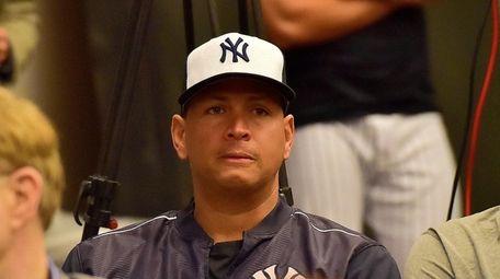 New York Yankees designated hitter Alex Rodriguez watches