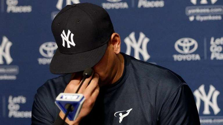 Alex Rodriguez reacts as he addresses the media