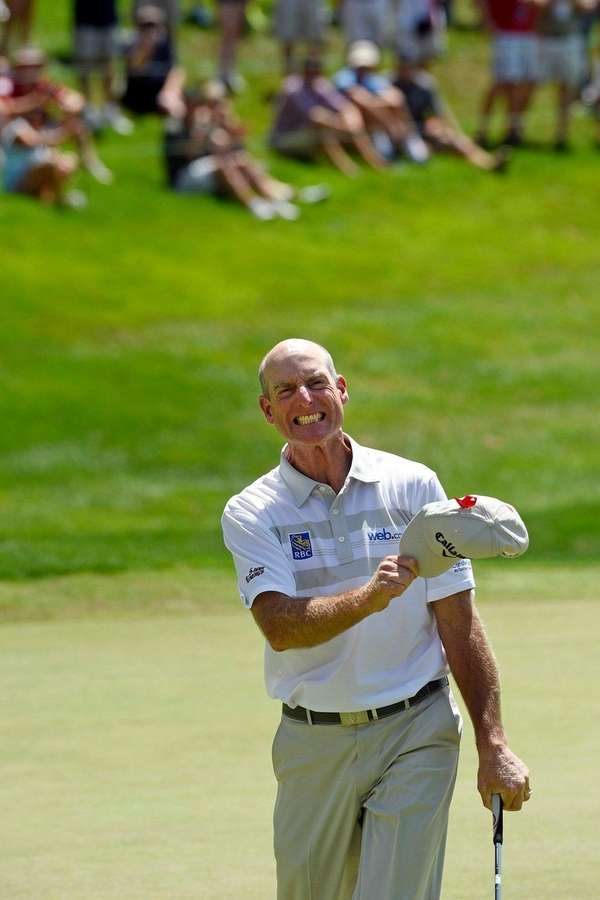 Jim Furyk celebrates after shooting a course and
