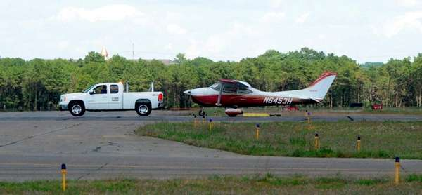 A small plane is towed away after it