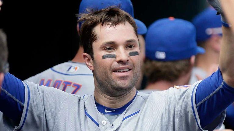 New York Mets' Neil Walker is congratulated in