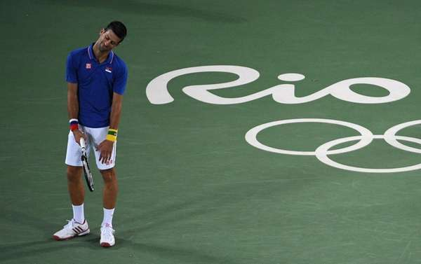 Serbia's Novak Djokovic reacts after losing a point