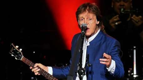Paul McCartney performs on stage at the MetLife