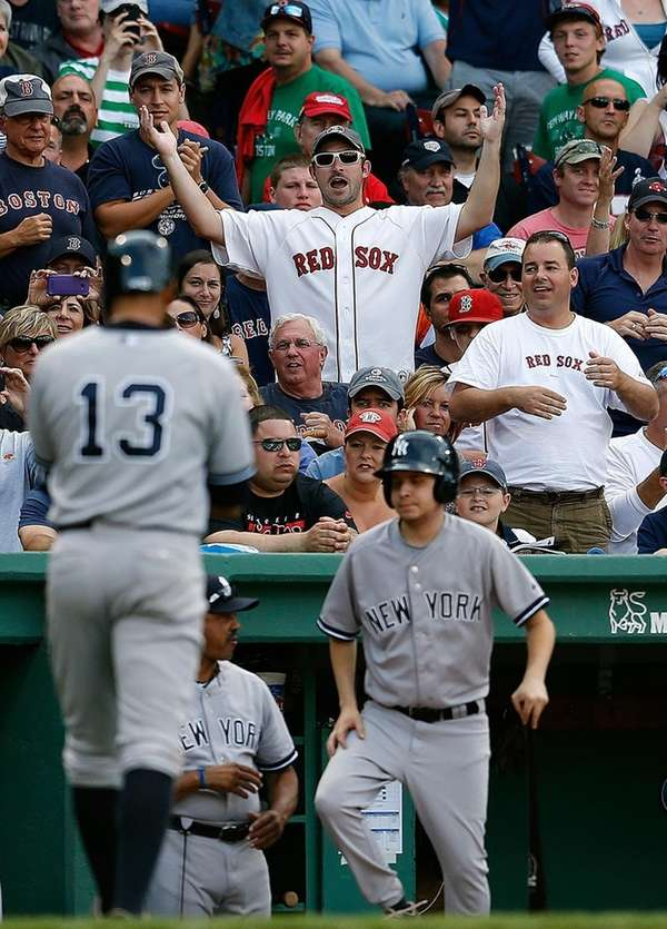 Fans reacts as Alex Rodriguez of the New