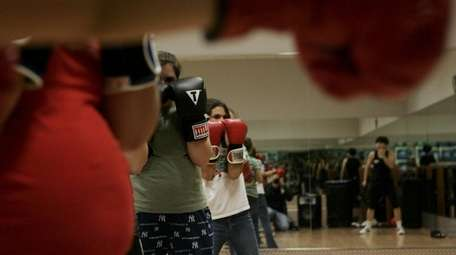 Kid boxing at Synergy Fitness on December 21,