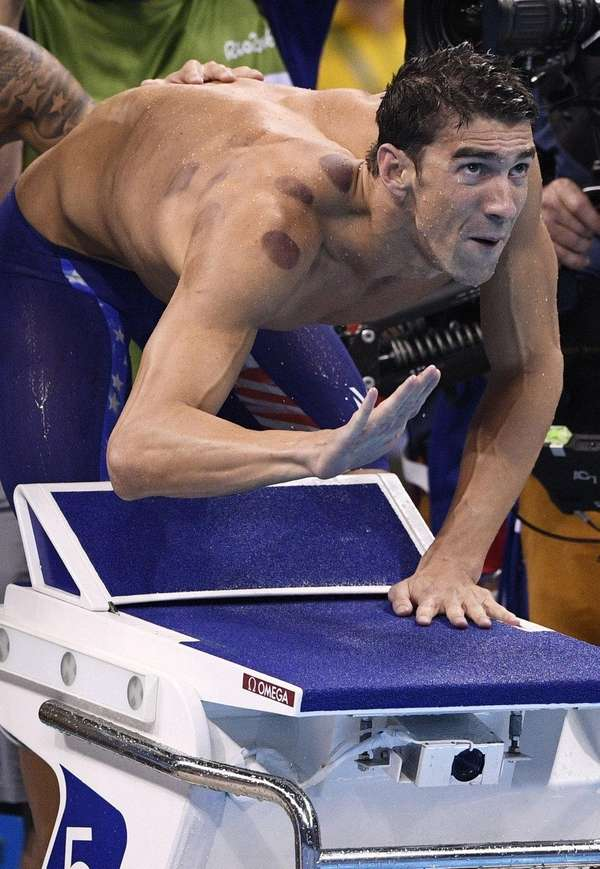 Michael Phelps takes part in the Men's 4x100m