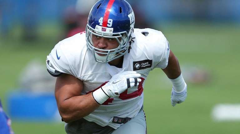 Giants fullback Nikita Whitlock runs a route during