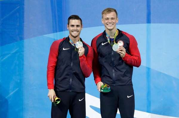 United States' silver medalists Steele Johnson, right, and