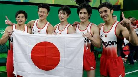 Japanese gymnasts, from left to right, Koji Yamamuro,