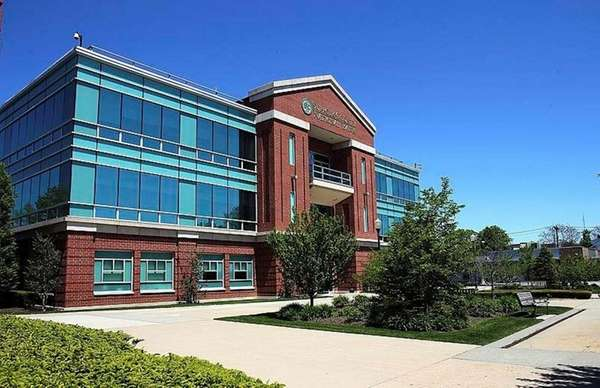 A lawsuit claims that Suffolk Bancorp improperly favored