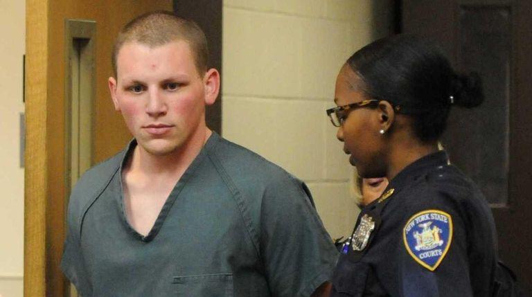 Adam Saalfield, 21, of Huntington Station, awaits arraignment