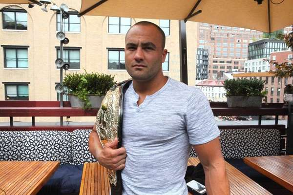 New UFC lightweight champion Eddie Alvarez poses with
