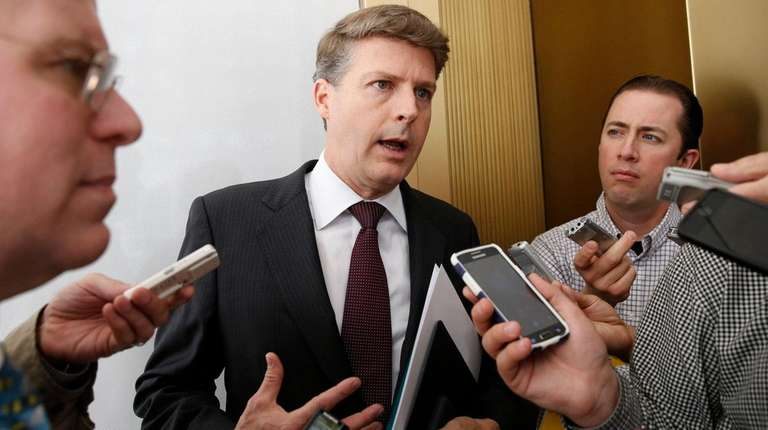 New York Yankees owner Hal Steinbrenner stops to