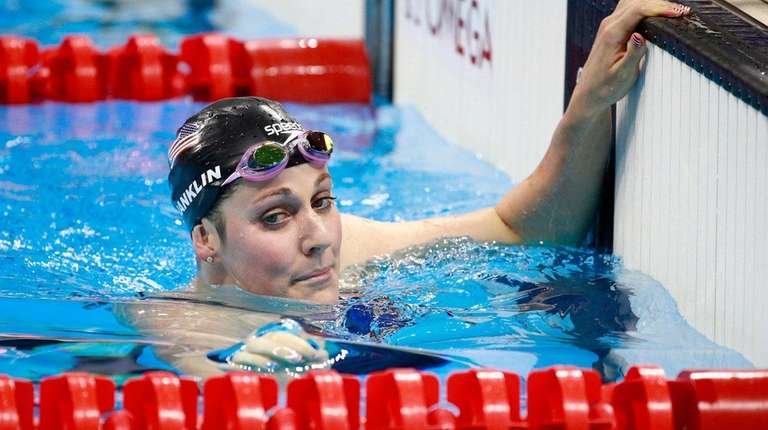 Missy Franklin of the United States reacts after