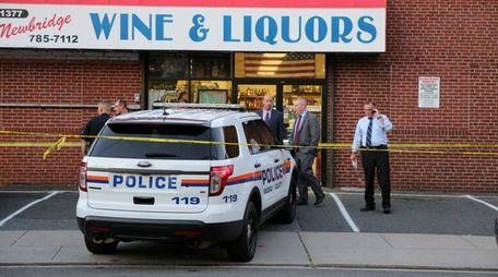 Police investigate the scene where shots were fired