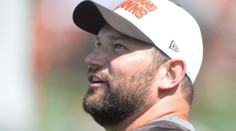 Cleveland Browns offensive lineman Joe Thomas stands on